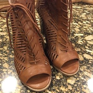 Tan lace up open toed booties